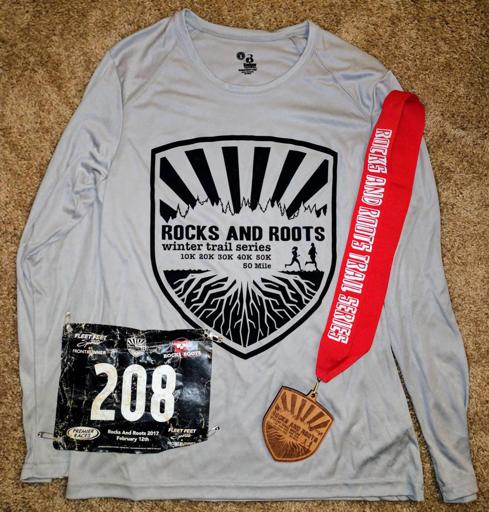 Rocks and Roots 50k shirt and medal