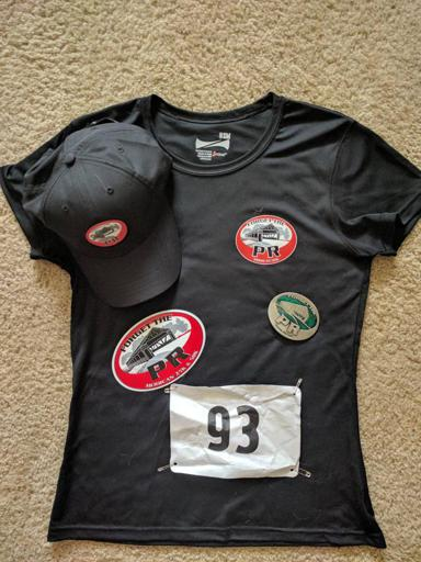 Forget the PR shirt, buckle, hat, sticker, and bib