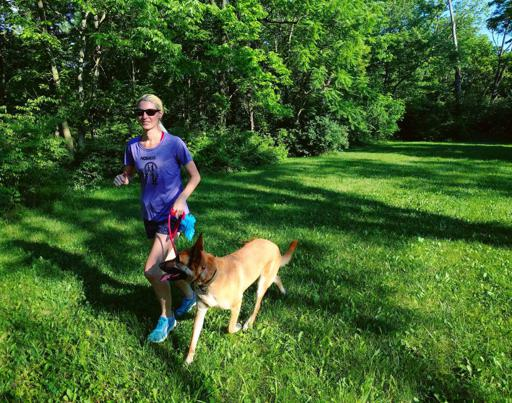 Running in XX2i Optics Bahamas1 Sunglasses with Belgian Malinois