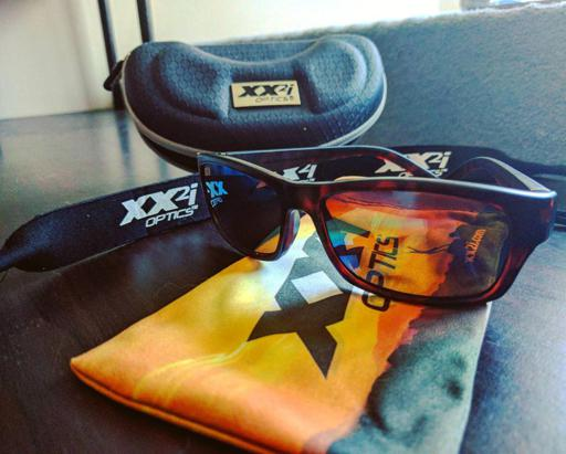 XX2i Optics Bahamas1 Sunglasses and Accessories Sitting on Table